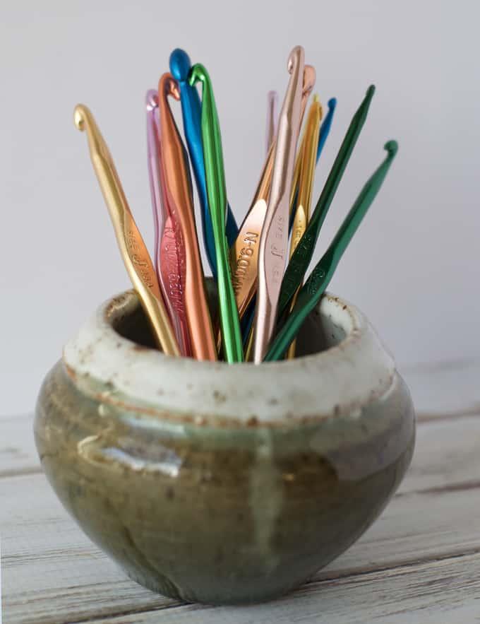 vase holding metal crochet hooks