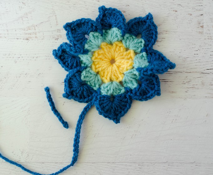 Yellow and blue crochet butterfly before assembly