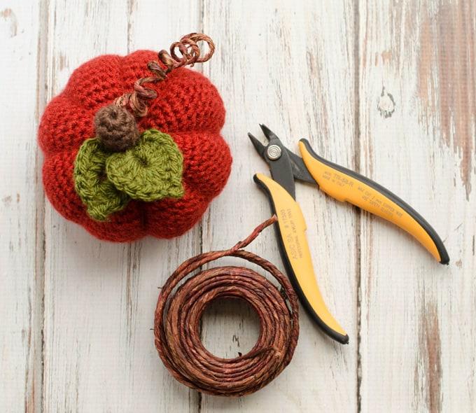 orange crochet pumpkin, florist wire and wire cutters