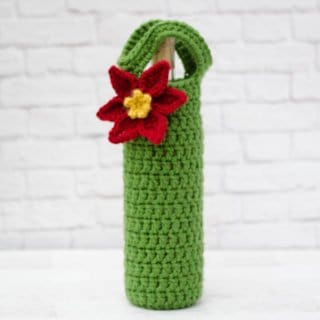 Crochet poinsettia wine cozy