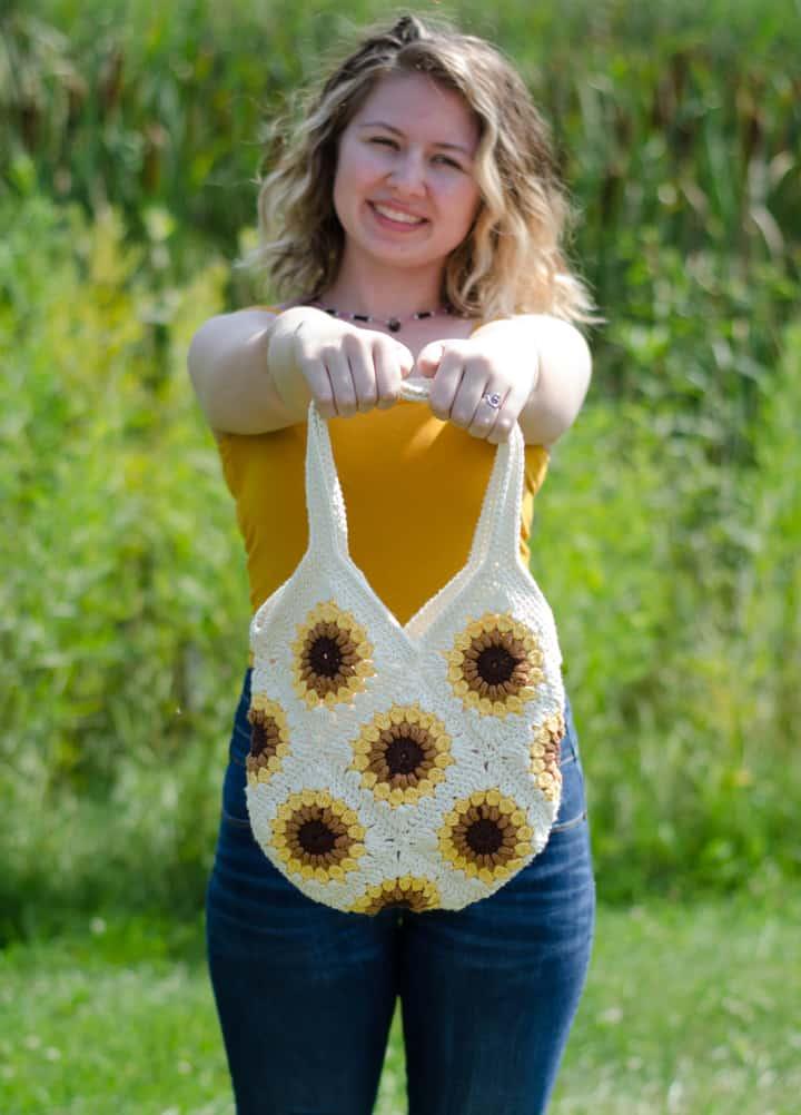 Girl holding crochet sunflower bag