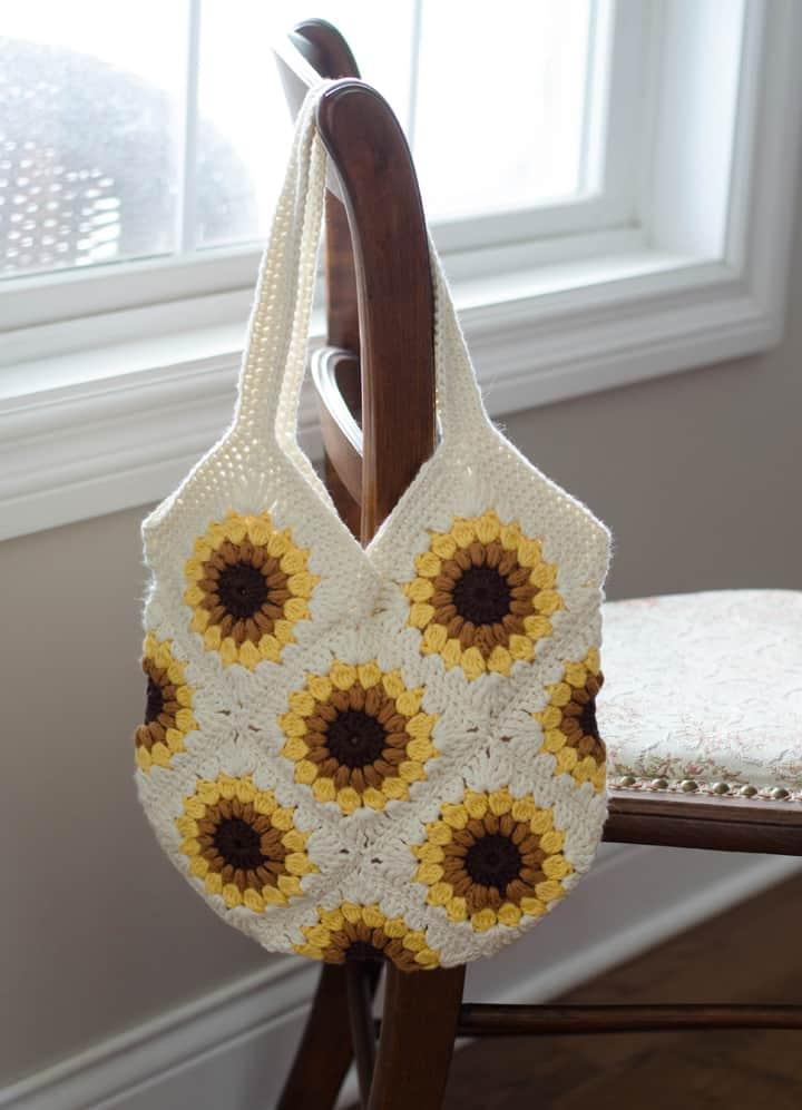 crochet sunflower bag over chair
