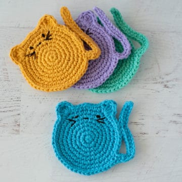 crochet cat coasters with embroidered features