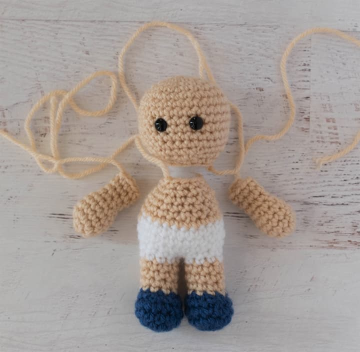unassembled crochet doll