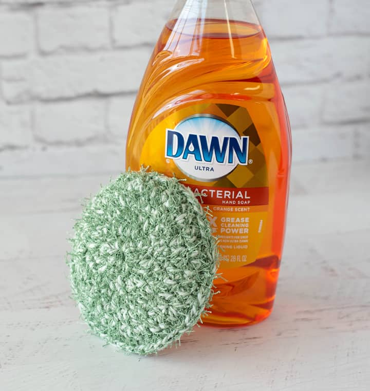 green crochet dish scrubber with Dawn Dish soap
