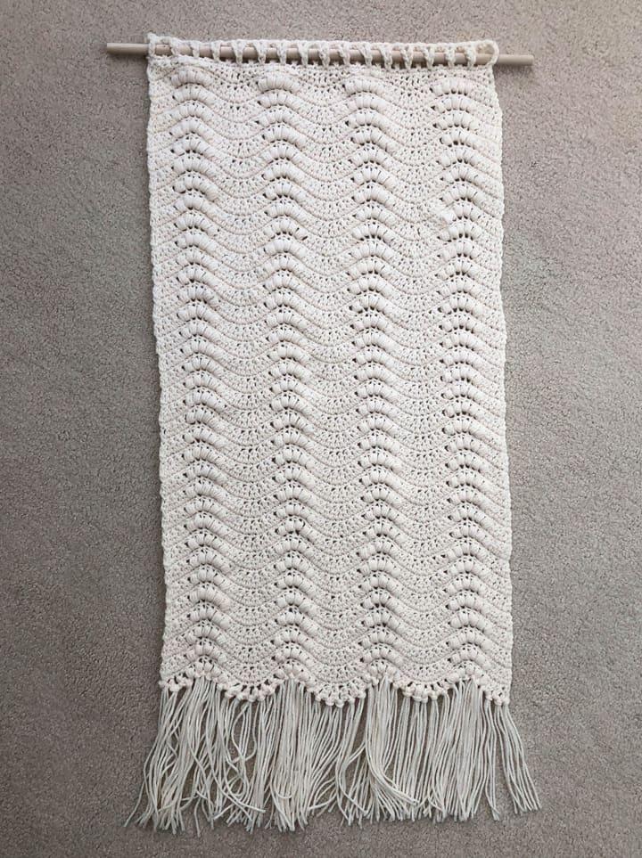 crochet wallhanging on floor