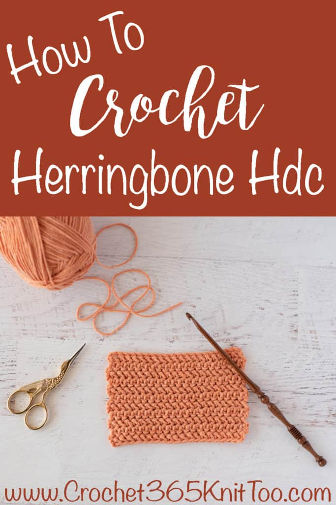 Herringbone hdc swatch with scissors and wooden hook