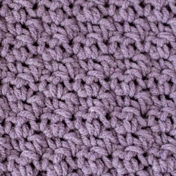 up close view of crochet soft moss stitch with purple yarn