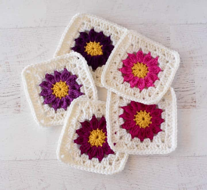crochet flower granny squares in pinks and purples