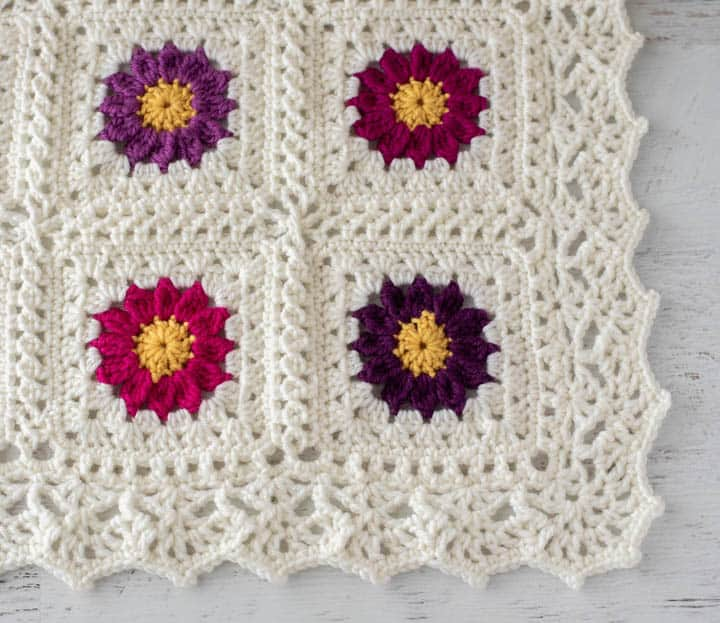 corner of lacy crochet flower afghan