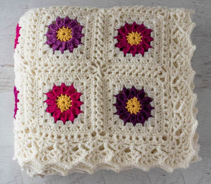 folded crochet afghan with lacy border