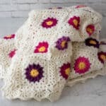 off white and vibrant pink and purple crochet afghan