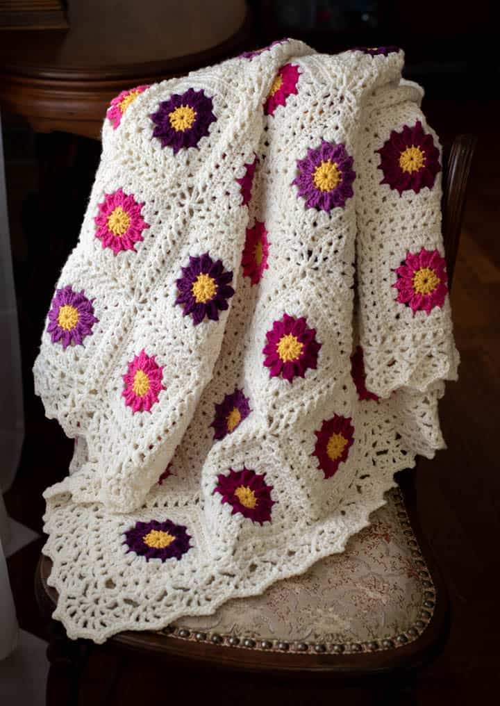 pink and purple and white granny square lacy crochet flower blanket