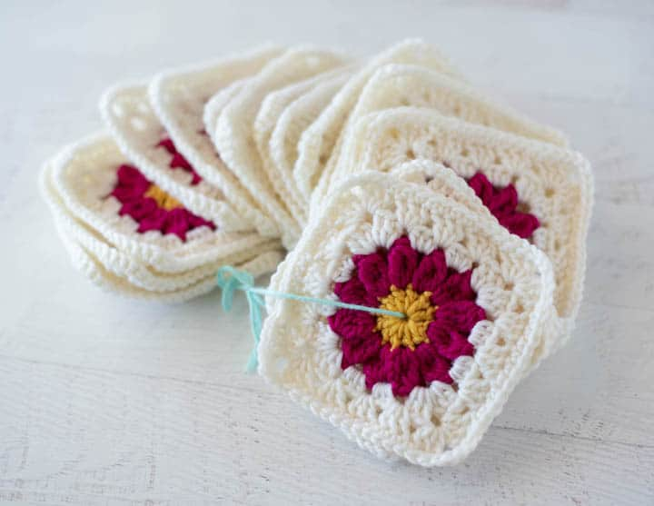 pink crochet granny squares on a string