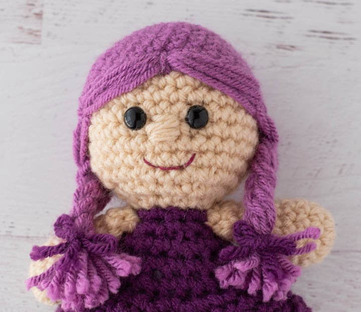 crochet doll with pink hair