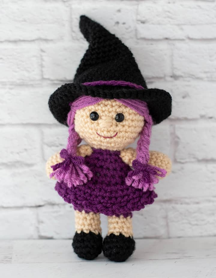 pink and purple crochet witch with black hat and shoes