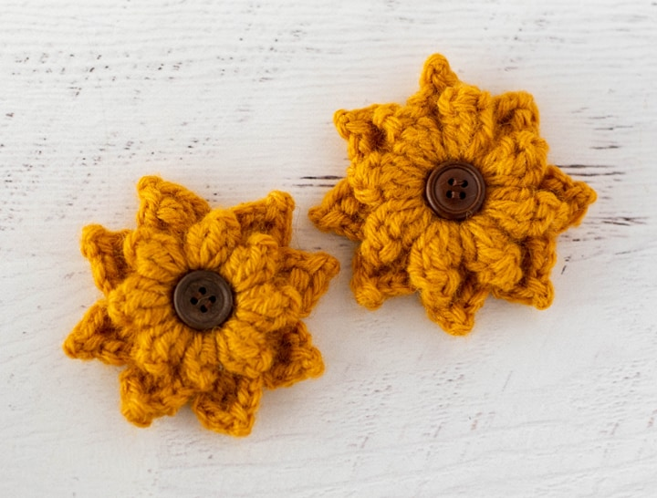 Black Eyed Susan crochet flowers in yellow yarn with brown button centers