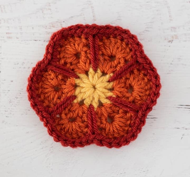 crochet african flower motif in yellow, orange and rust