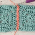 blue crochet granny squares with pink zig zag slip stitch join