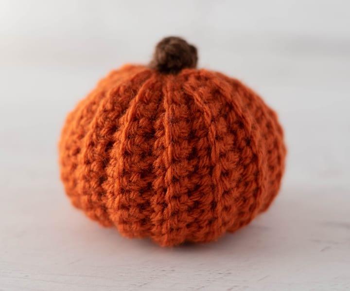 orange crochet pumpkin with brown stem