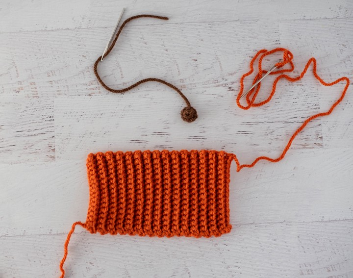 orange and brown crochet pieces
