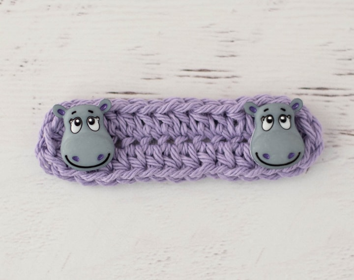 Purple crochet ear saver with hippo button