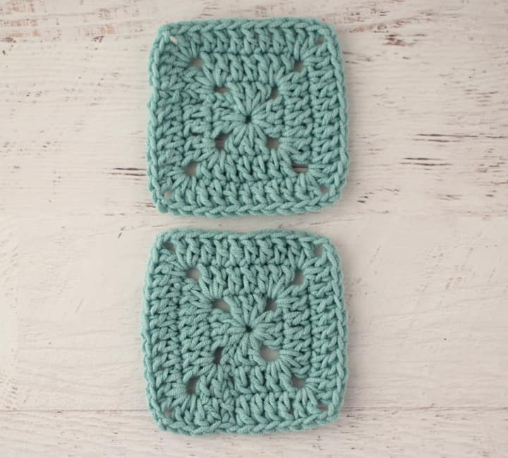 two blue crochet granny squares