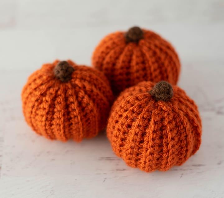 3 orange crochet pumpkins