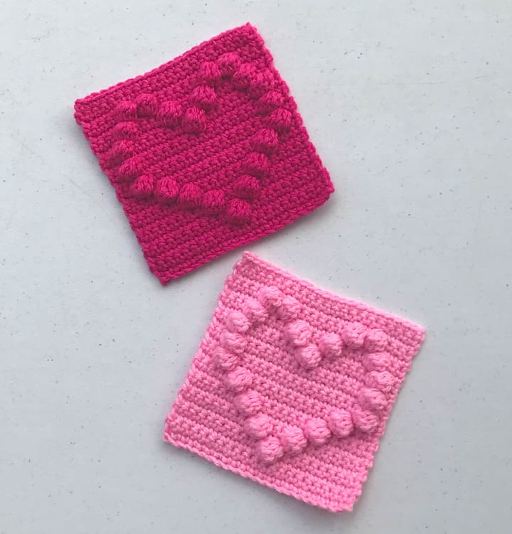 Pink crochet squares with raised hearts