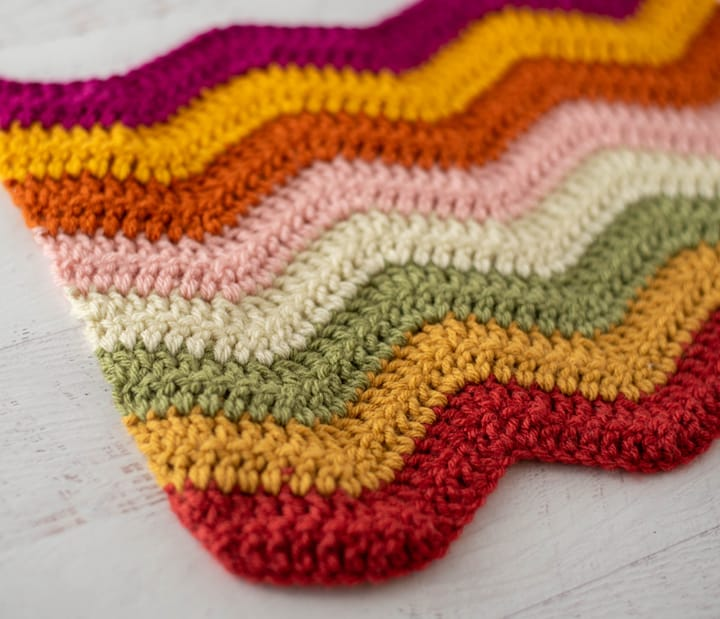 pink, yellow, orange, green and off white crochet afghan sample