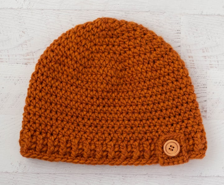 Rust color crochet hat with wood button