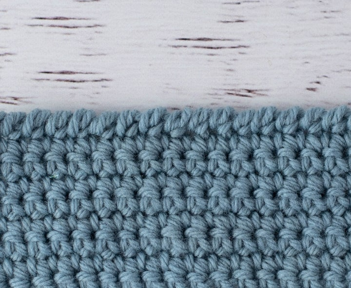 blue crochet piece demonstrating reverse single crochet stitch