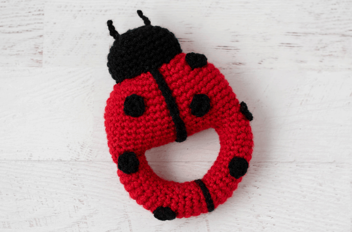 Red crochet ladybug with black spots and head