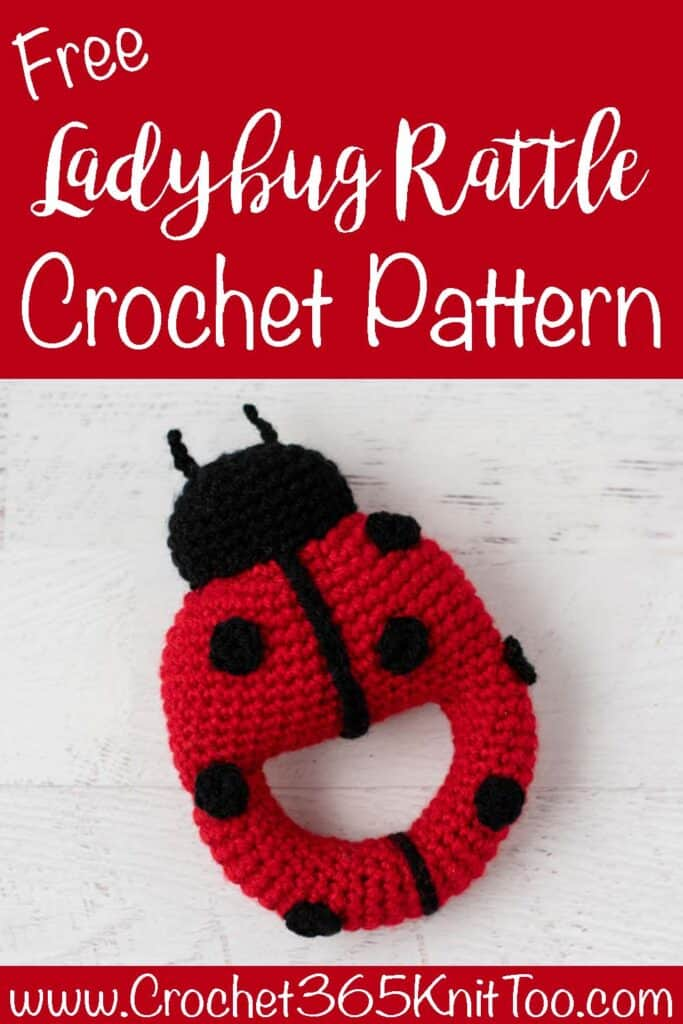 Red crochet ladybug with black spots and head with text