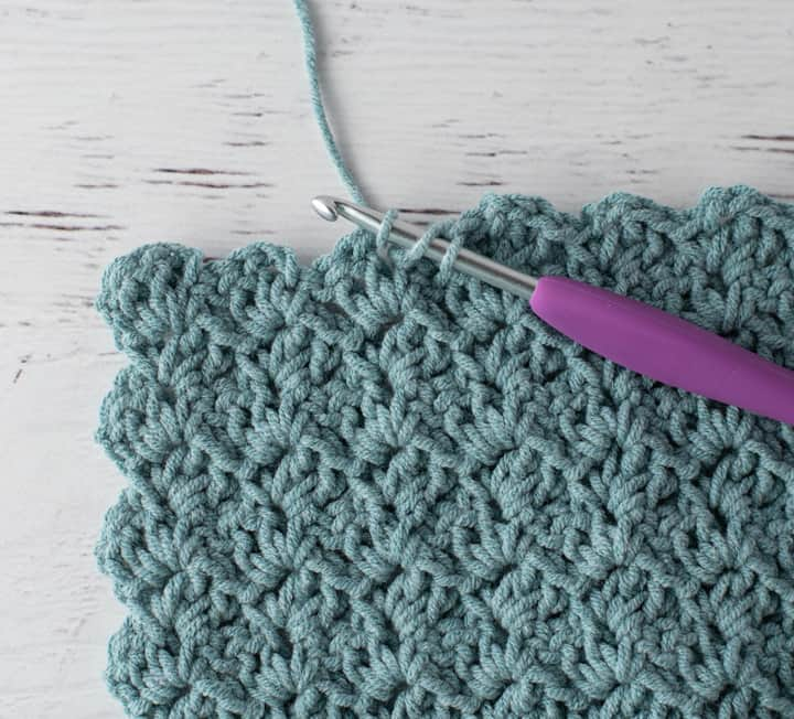 crochet tulip stitch in blue yarn with purple hook