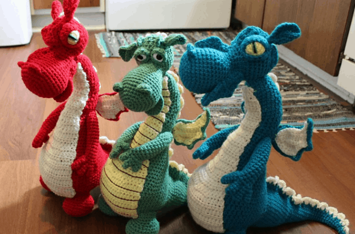 three crochet amigurumi dragons