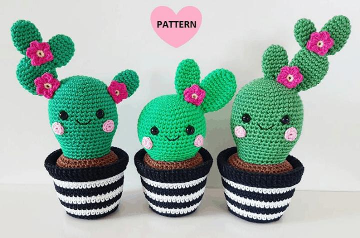 three crochet cactuses