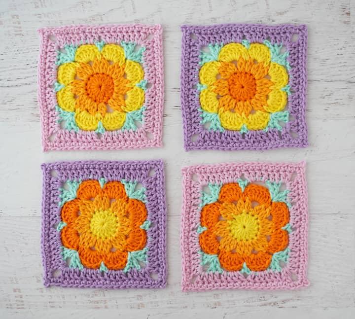 4 sous-verres de fleurs au crochet aux couleurs rose, violet, jaune et orange