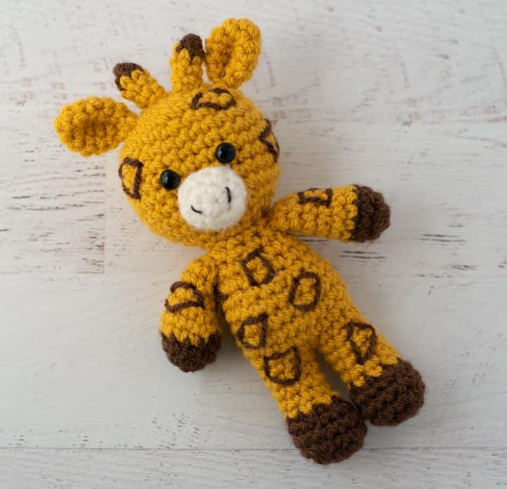 yellow and brown crochet stuffed giraffe