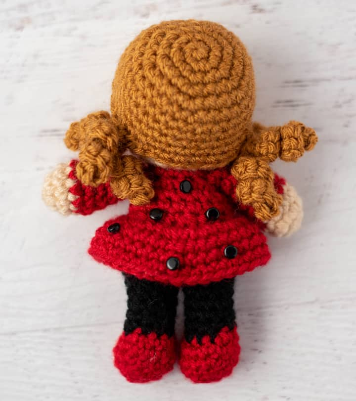 back of crochet doll with gold hair
