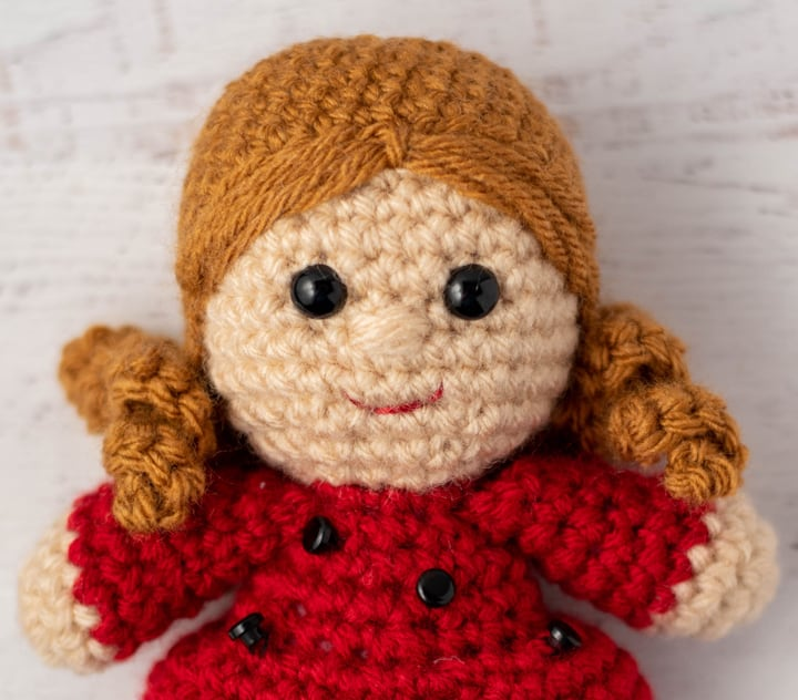 close up view of crochet doll head and hair