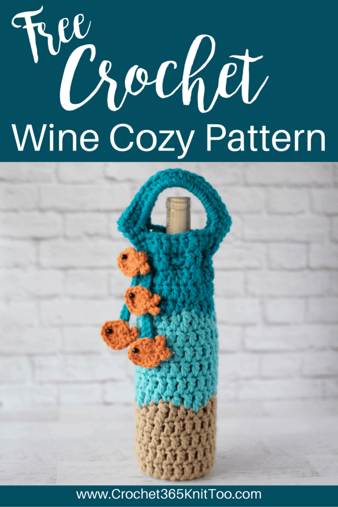crochet wine cozy in blue, light brown with a blue tie with gold fish